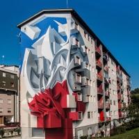 צורות מופשטות וציורים תלת מימדיים על בניינים. ביצוע של פיטה